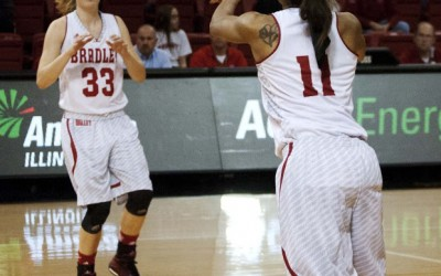 Freshman Madison Dellamuth drives toward the hoop in an exhibition game against Eureka College.
