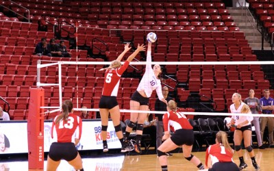 Freshman Jamie LIvaudais attempts a block in Bradley's first win of the season against Evansville. Photo by Dan Smith