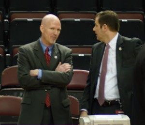 Outgoing Director of Athletics Michael Cross talks to current Associate AD for External Affairs Brett Burchette before the Bradley-Loyola game yesterday.