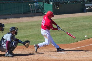 Senior outfielder Isaac Smith swings at a pitch against SIU in March. Smith homered to lead the Braves past Iowa Tuesday. Photo by Dan Smith.