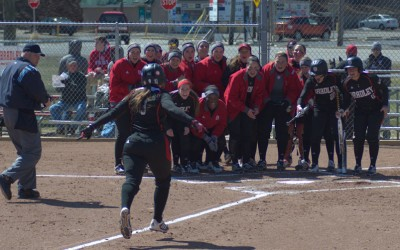 The Bradley softball team gathers at home plate to celebrate Lexi Cremeens' (9) home run in a game against Loyola-Chicago last month. The Braves finish the regular season against Evansville this weekend. Photo from Scout Archives.
