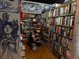 Lit. on Fire Used Books is located a few blocks from campus and offers used books at a discounted price to students, as well as space on its bookshelves to doodle and monthly open mic nights. Photo by Tori Moses.