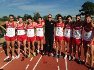 Darren Gauson (center) led the Lamar Cardinals' cross country pro- grams to consecutive conference championships in 2013 and 2014. Photo via Darren Gauson's Twitter page.