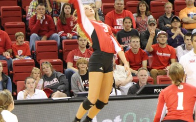 Freshman Erica Haslag rises for a kill in a match against DePaul. Photo by Ann Schnabel.