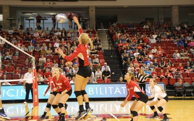 Sophomore Jamie Livudais rises for a spike during a game against DePaul. Livudais is third on the team in kills with 89. Photo by Adam Rubinberg.