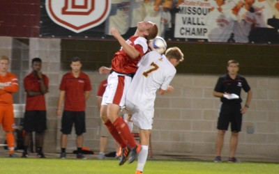 Sophomore defender Jacob Taylor goes up to challenge a Rambler player for a header during the Braves' 1-0 homecoming win against Loyola Sept. 25. Photo by Anna Foley.