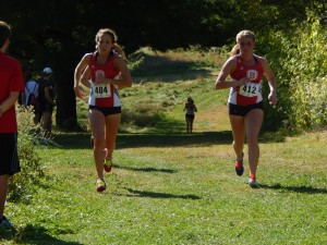 Junior Rebecca Gosselin (left) and freshman Brooke Nusser (right) run side by side during the Bradley Invitational at Donovan Park. Photo by Chris Kwiecinski.