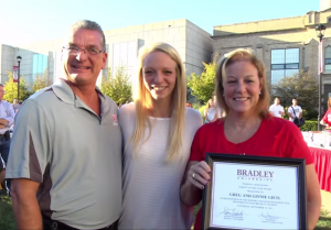 Greg and Ginnie Gietl stand with daughter Kassidy, a senior nursing student, after being named parents of the year during this year's Family Weekend. Photo provided by Bradley University.