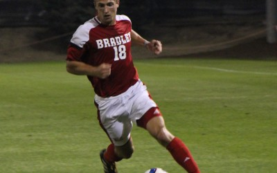 Grant Bell handles the ball in a game earlier this season. Bell is one of three seniors on the Bradley soccer team. Photo by Ann Schnabel.