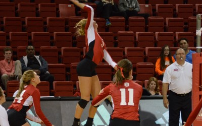 Bradley's Erica Haslag (center) rises for a spike in a game agaisnt Wichita State. Haslag has the sixth most kills in a season for a Bradley freshman. Photo by Anna Foley.