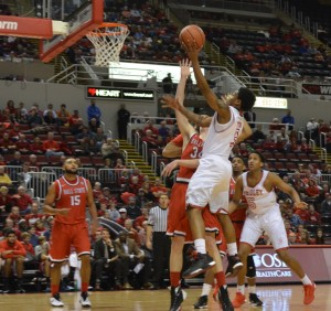 Antoine Pittman (center) goes for a layup in a game against Ball State, Nov. 13. The win against Ball State is Bradley's lone win of the year. Photo by Moira Nolan.