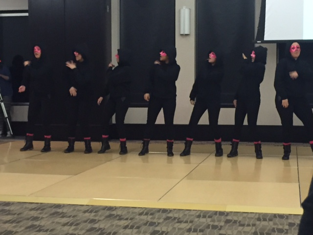 The nine new members of Sigma Lambda Gamma at Bradley performed a routine at their neophyte presentation Saturday. Photo by Michael Echeverri.
