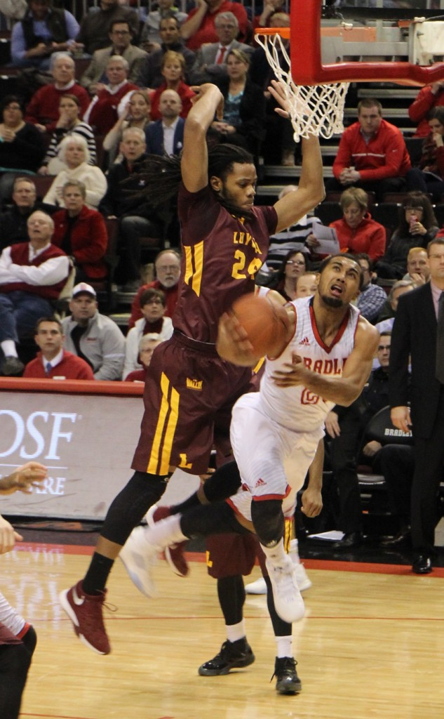 Freshman guard Dwayne Lautier-Ogunleye tries a reverse layup during a game against Loyola-Chicago. Lautier-Ogunleye led all Braves with 18 points. Photo by Ann Schnabel.