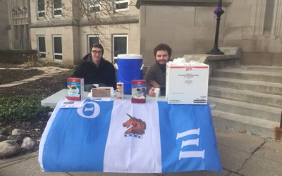 Members of Theta Xi hand out cups of coffee in front of Bradley Hall Wednesday to support Three Avocados, a non-profit coffee company. Photo by Michael Echeverri.