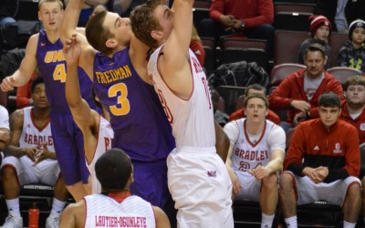 Luuk van Bree (center) goes up for a rebound in a game against Northern Iowa. Van Bree is third on the Braves with 4.3 rebounds per game. Photo by Anna Foley.