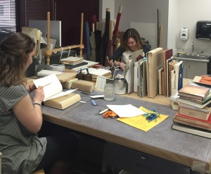 Students work on the third floor of the Cullom-Davis Library to restore books. Most repairs involve replacing covers or bindings. Photo by Tessa Armich.