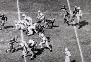 Johnny Bright (top right) gets struck by Wilbanks Smith during Drake's game against Oklahoma A&M Oct. 20, 1951. The photo, by Don Ultang, won a Pulitzer Prise, and first ran in the Des Moines Register, but gained national attention when it ran in the sports section of the New York Times. Photo via SlideShare.net.