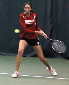 Freshman Malini Wijesinghe hits a backhand return in a match in April against Southern Illinois. Photo by Ann Schnabel.