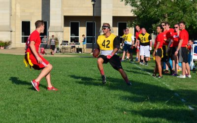 Member of faculty Marshall Escue attempt to juke senior Brock Fuhrmann in the Bradley Bowl. Photo by Eytan Herman.