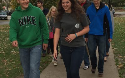 "Students participate in the ""Walk A Mile In Her Shoes"" event to spread awareness about domestic violence in 2015. This year's event will be at 11 a.m. Oct. 2 on Olin Quad. Photo via Alpha Chi Omega sorority."