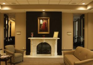 A painting of young Lydia, created by Bradley artist-in-residence Donna Carr Roberts, hangs above a replica of the Bradley's original fireplace in the Hayden-Clark Alumni Center. photo by Brien Jackson