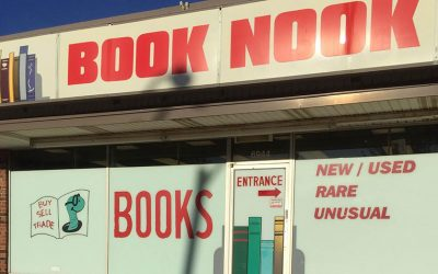 Book Nook, located at 6944 N. University St., has an inventory of about 120,000 used books and also features work from local authors. photos by Tori Moses