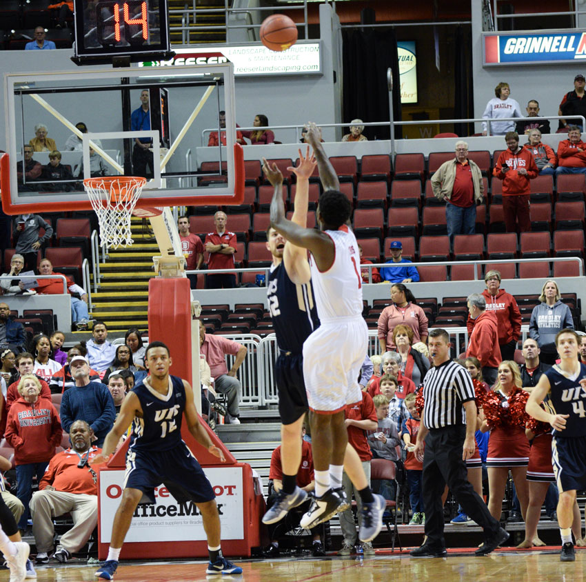 Junior Donte Thomas puts up a contested shot in a win earlier this year against Illinois-Springfield. photo by Justin Limoges