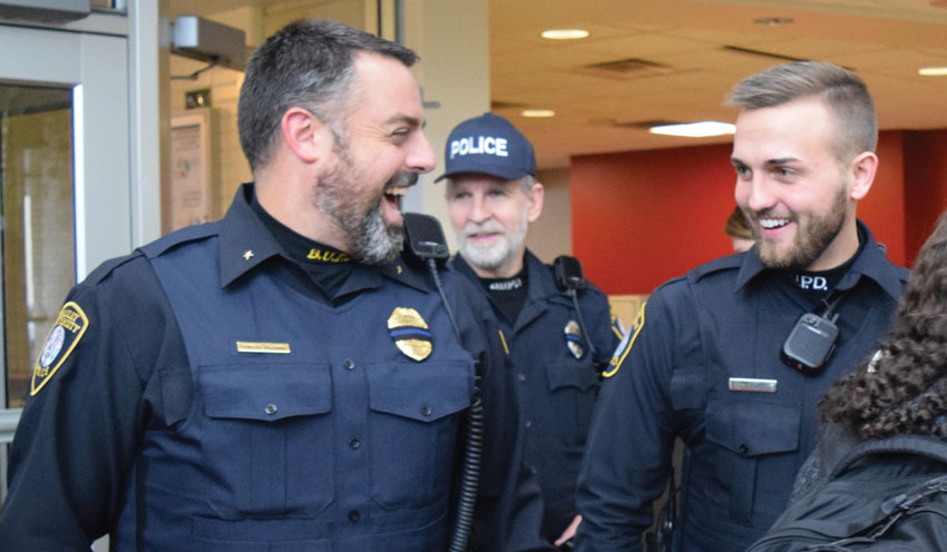 Bradley University Police Department Chief Brian Joschko (left) and Officer Sean Savage (right) show off their beards in Michel Student Center Wednesday after participating in No Shave November to raise mon- ey for the Special Olympics of Illinois. photo by Shelby Caruso