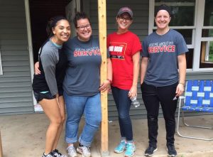 Students volunteer with Habitat for Humanity in order to build a home in honor of Ashley Borja, a junior mechanical engineering major who died last spring in a car accident. Photo via Amanda Hammer