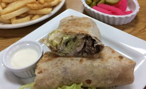 A shawarma wrap from Shawarma Grill costs $10, and the restaurant offers $5 off all entrees for Bradley students. photo by Mitch Taylor