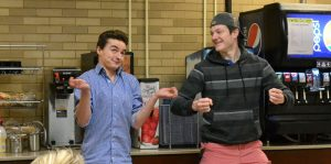 BBQ Kitten members Will Jacobs and Mason Boore play a game called 'Freeze' to warm up during a re- hearsal Wednesday night in the cafeteria of Williams Hall. photo by Cenn Hall