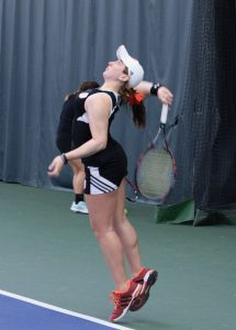 Senior Ariel Dechter serves in a home match earlier this season. photo by Justin Limoges