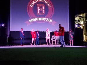 The homecoming court line up socially distanced while Vice President of Student Affairs Nathan Thomas announces the king and queen. Photo by Angeline Schmelzer