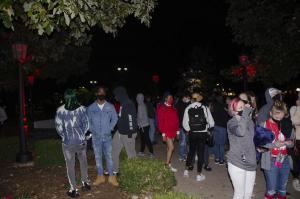 Students stand around while waiting for the B to light while wearing masks, despite social distancing guidelines. Photo by Kayla Johnson